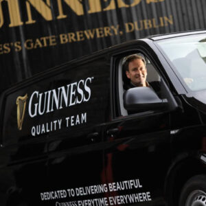 Guinness quality team driver in front of the gates